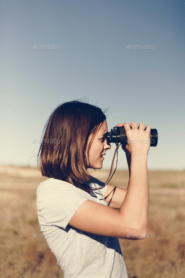 Traveler Using Binoculars - Stock Photo - Images