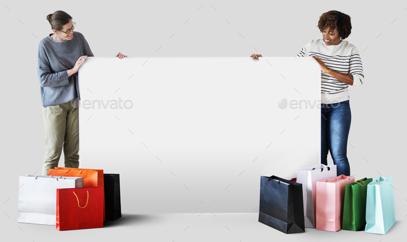 Women with shopping bags and a banner - Stock Photo - Images