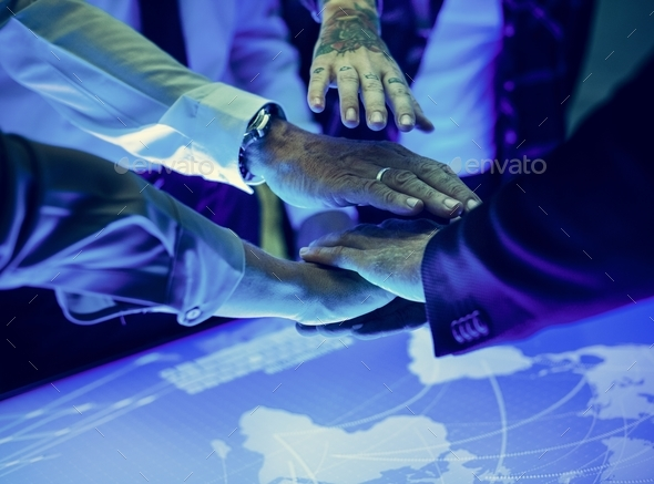 Hands join together in a technology meeting - Stock Photo - Images