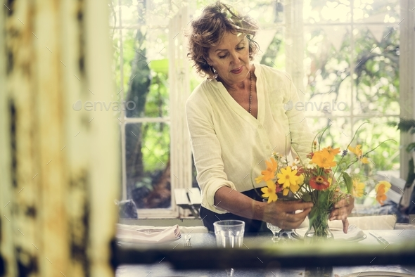 Woman arranging flowers - Stock Photo - Images