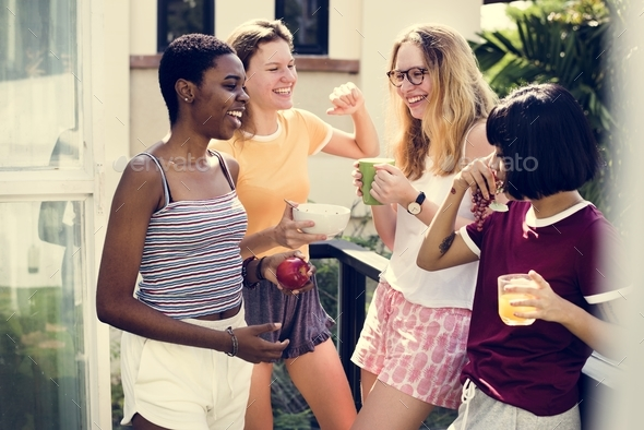 A group of diverse women talking to one another - Stock Photo - Images