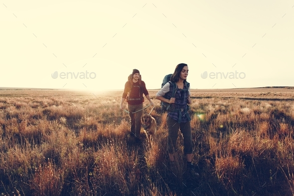 Couple hiking together in the wilderness - Stock Photo - Images