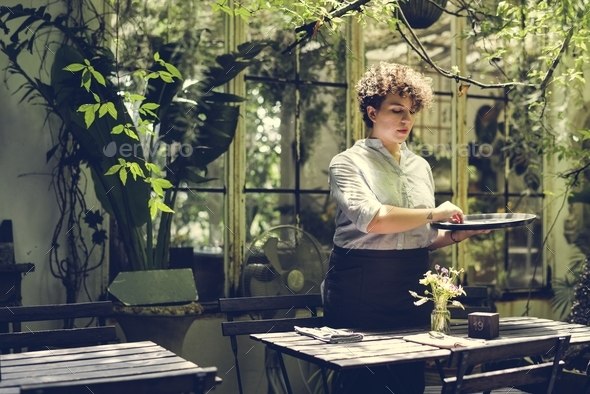Woman working in a gardening shop - Stock Photo - Images