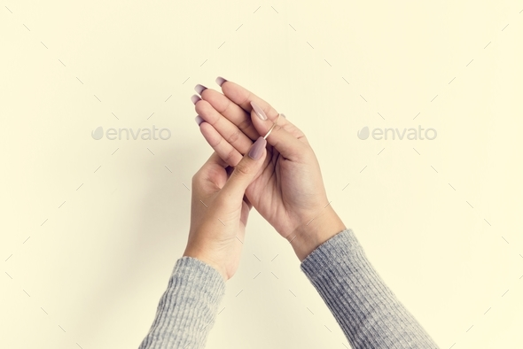 Closeup of woman hands with long sleeve isolated on white - Stock Photo - Images