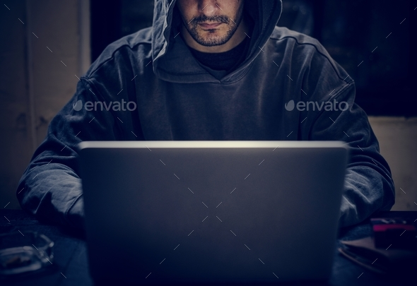 Hacker working on computer cyber crime - Stock Photo - Images