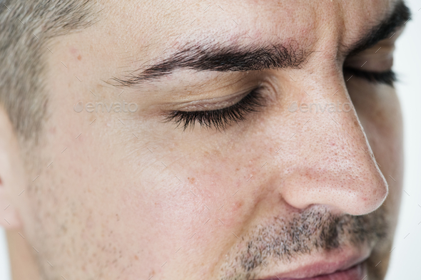 Side portrait of white man closeup on closed eyes - Stock Photo - Images