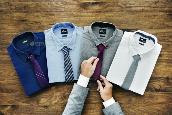 Businessman arranging his formal wear - Stock Photo - Images