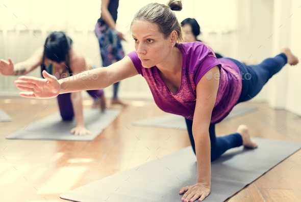 Pregnant woman in yoga class - Stock Photo - Images