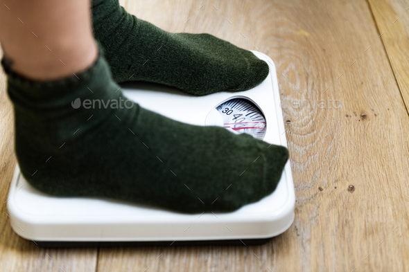 Woman on weight scale - Stock Photo - Images
