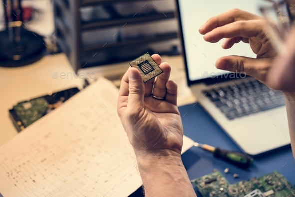 Closeup of hands with computer mainboard microprocessor electronics parts - Stock Photo - Images