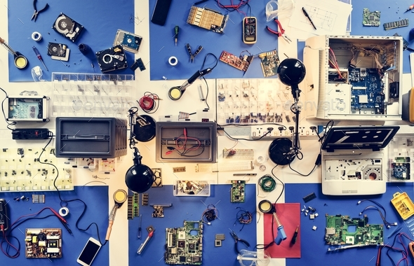 Aerial view of electronics technicians table workshop - Stock Photo - Images