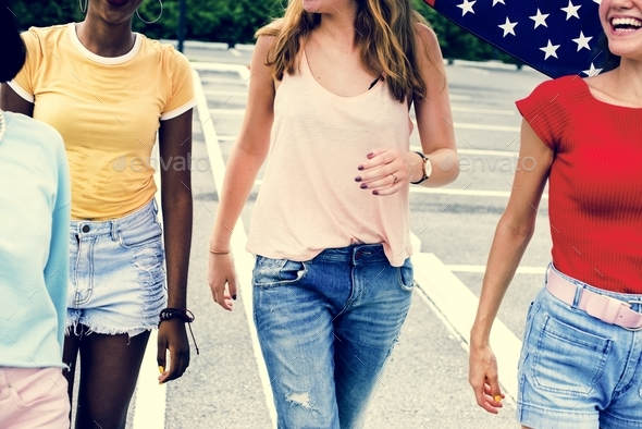 A diverse group of women walking together - Stock Photo - Images