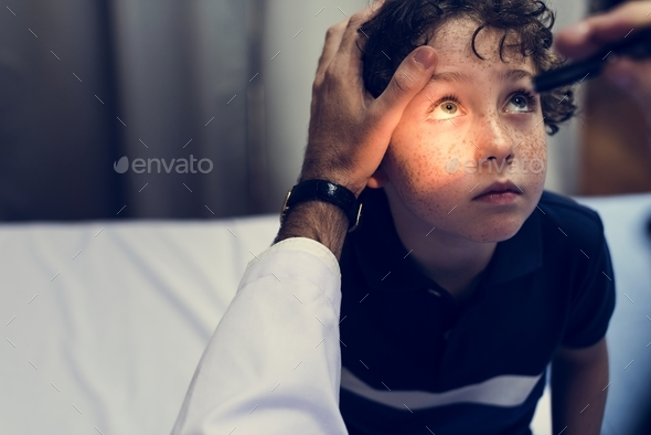 Young boy having his eyes checked - Stock Photo - Images