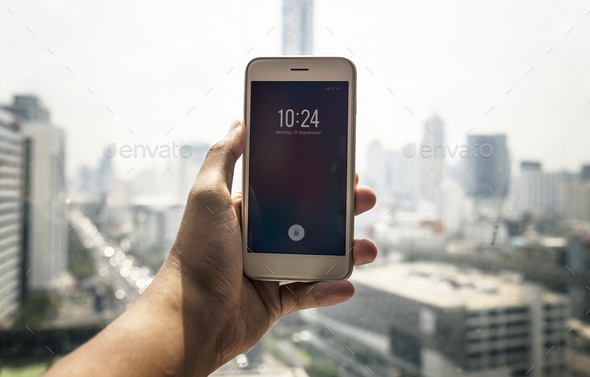 Person checking the time on phone - Stock Photo - Images