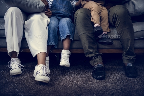 Closeup of family sitting on the couch - Stock Photo - Images