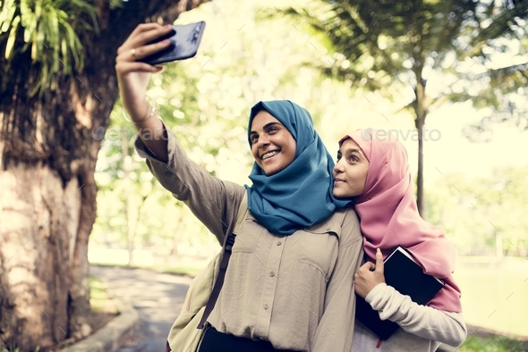 Group of students using mobile phone - Stock Photo - Images