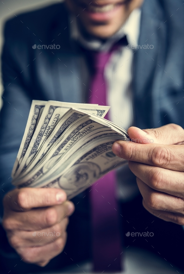 A person carrying a lot of cash - Stock Photo - Images
