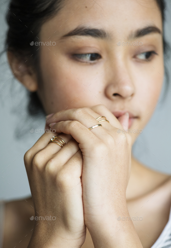 Serious young Asian girl portrait thinking - Stock Photo - Images