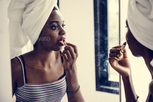 Rear view of black woman with lipstick - Stock Photo - Images