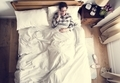 Smiling Caucasian woman on bed talking on the phone - PhotoDune Item for Sale