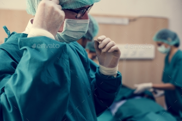 Doctors preparing for an operation - Stock Photo - Images