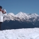 Man with Snowboard Watching the Mountains - VideoHive Item for Sale