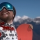 Portrait of a Happy Snowboarder in the Mountains - VideoHive Item for Sale