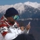Snowboarder Using Mobile Phone in the Mountains - VideoHive Item for Sale
