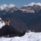 Snowboarder Using Cell Phone in the Mountains - VideoHive Item for Sale