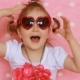 Cute Little Girl Fashionista Smiles, Laughs and Shows Tongue. Pink Background - VideoHive Item for Sale