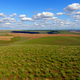 Rolling Green Hills Agricultural Land Partly Cloudy Blue Sky - PhotoDune Item for Sale
