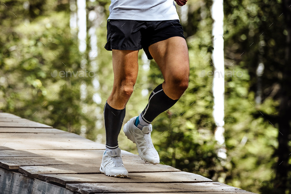 man runner in compression socks - Stock Photo - Images