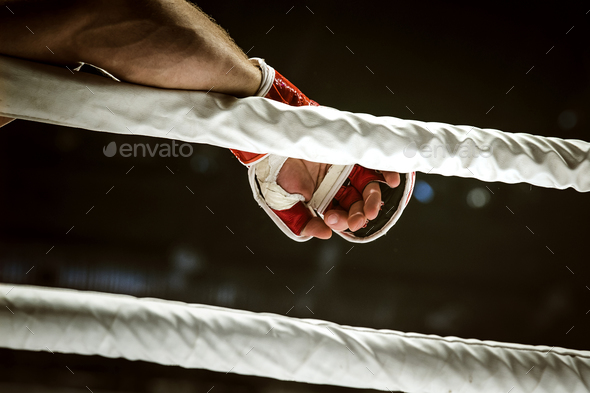 MMA fighter hand in glove - Stock Photo - Images