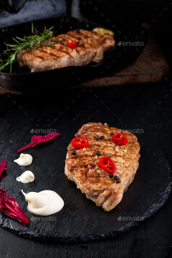Grilled pork steak on slate plate. - Stock Photo - Images