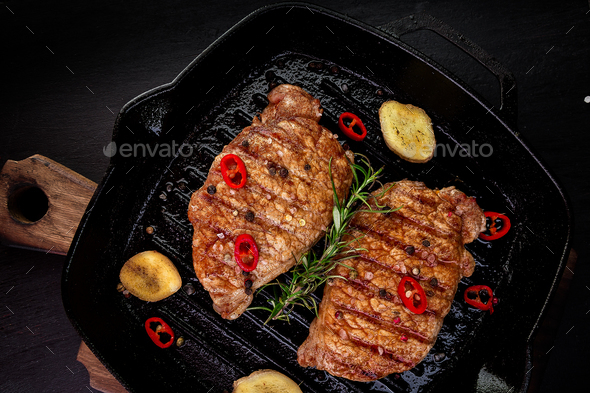 Grilled pork steak in grill pan - Stock Photo - Images