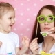 Mother and Daughter Play Together, Laugh and Dress Glasses and Blowing Horns - VideoHive Item for Sale