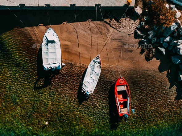Aerial view of a wooden fishing boats in the sea. - Stock Photo - Images