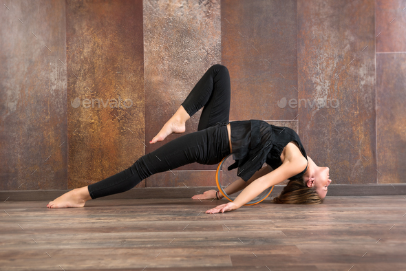 Young fit woman doing matsyasana yoga pose - Stock Photo - Images