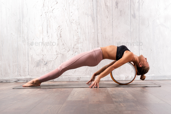 Young fit woman doing purvottanasana yoga pose - Stock Photo - Images