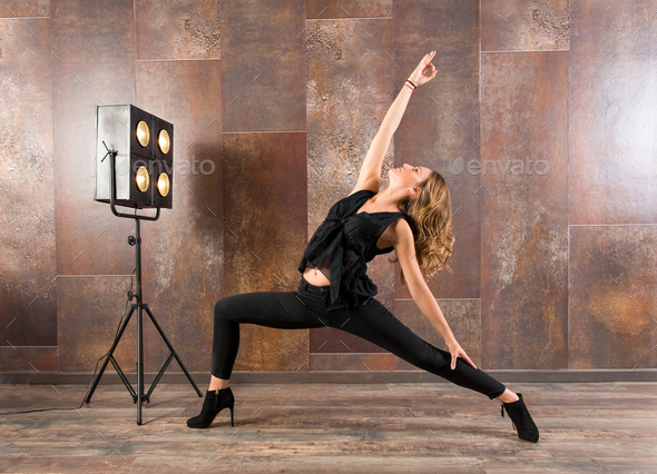 Fit woman doing virabhadrasana yoga pose - Stock Photo - Images