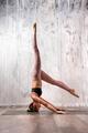 Fit woman doing variation of sirsasana yoga pose - PhotoDune Item for Sale
