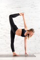 Fit woman doing ardha chandra chapasana yoga pose - PhotoDune Item for Sale