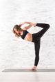 Young fit woman doing natarajasana yoga pose - PhotoDune Item for Sale