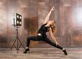 Fit woman doing virabhadrasana yoga pose - PhotoDune Item for Sale