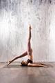 Fit woman doing salamba sarvangasana yoga pose - PhotoDune Item for Sale