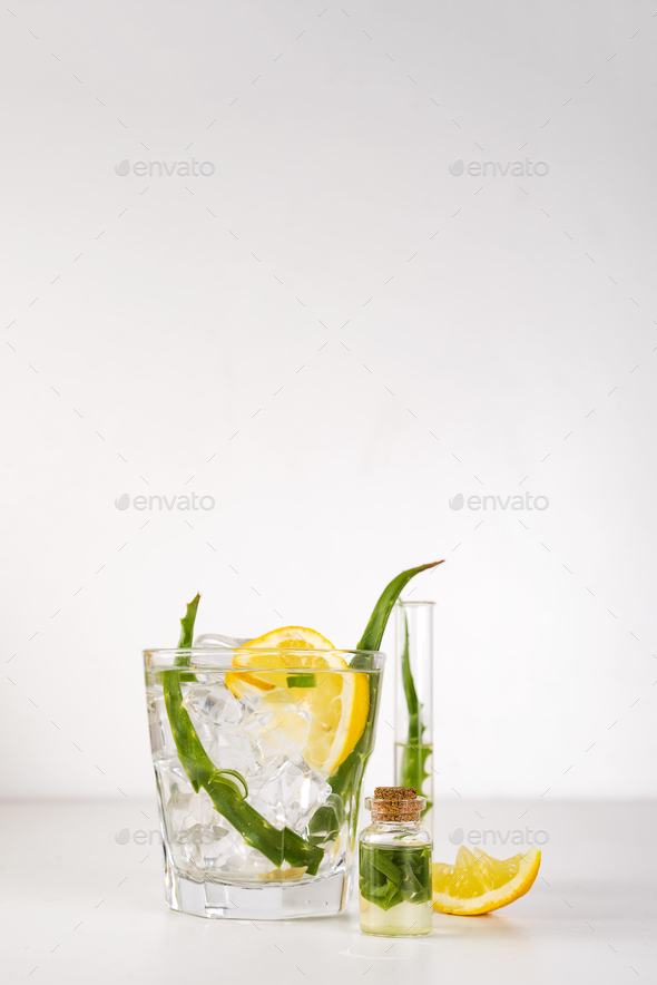 fresh aloe vera leaves and aloe vera juice in glass on white background - Stock Photo - Images