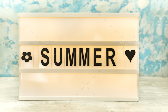 Summer letter on the led board on table. Concept of summer tourism, travel and vacation - Stock Photo - Images