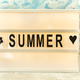 Summer letter on the led board on table. Concept of summer tourism, travel and vacation - PhotoDune Item for Sale
