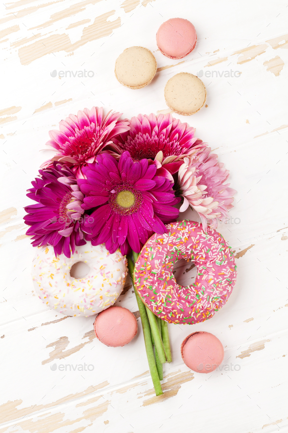 Donuts and gerbera flowers bouquet - Stock Photo - Images