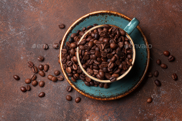 Coffee cup with roasted beans - Stock Photo - Images